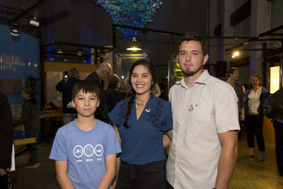 Artists Daniel Ranger, Laura Mendes and John Loerchner help unveil DEEP BLUE, a stunning, community-based art installation comprised of more than 2000 origami shapes, at the Ontario Science Centre today. DEEP BLUE showcases the ecology – and grandeur – of Lake Ontario. (CNW Group/Ontario Science Centre)