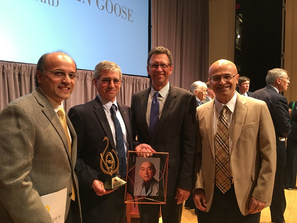 At the 2017 Golden Goose Award Ceremony, from left to right: Dr. Saied Tadayon (CTO of ZAC), Prof. David Culler (Interim Dean of Data Sciences, U.C. Berkeley) accepting the award on behalf of Prof. Zadeh, Mr. Frank Sesno (Director of School of Media and Public Affairs, George Washington University, and former CNN anchor) acting as the master of ceremony, and Dr. Bijan Tadayon (CEO of ZAC).