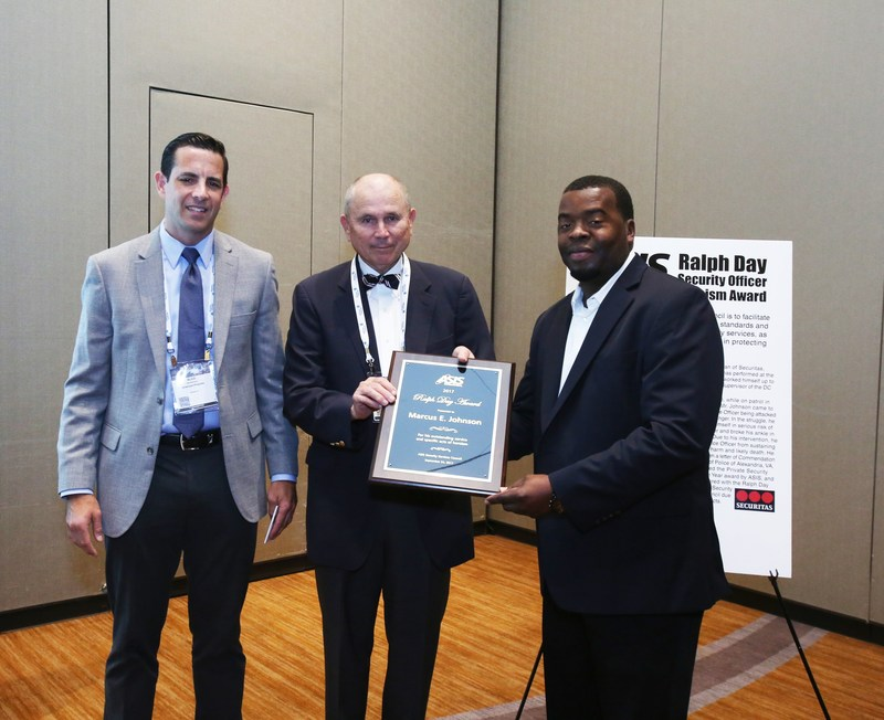 Securitas Mobile Security Officer Marcus Johnson (right) received the Ralph Day Security Officer of the Year Award from the ASIS Security Services Council in recognition of his heroic actions while on duty. Also pictured (left to right),  Vice President Blair Brownyard and President Bruce Brownyard of Brownyard Programs which sponsors the award.