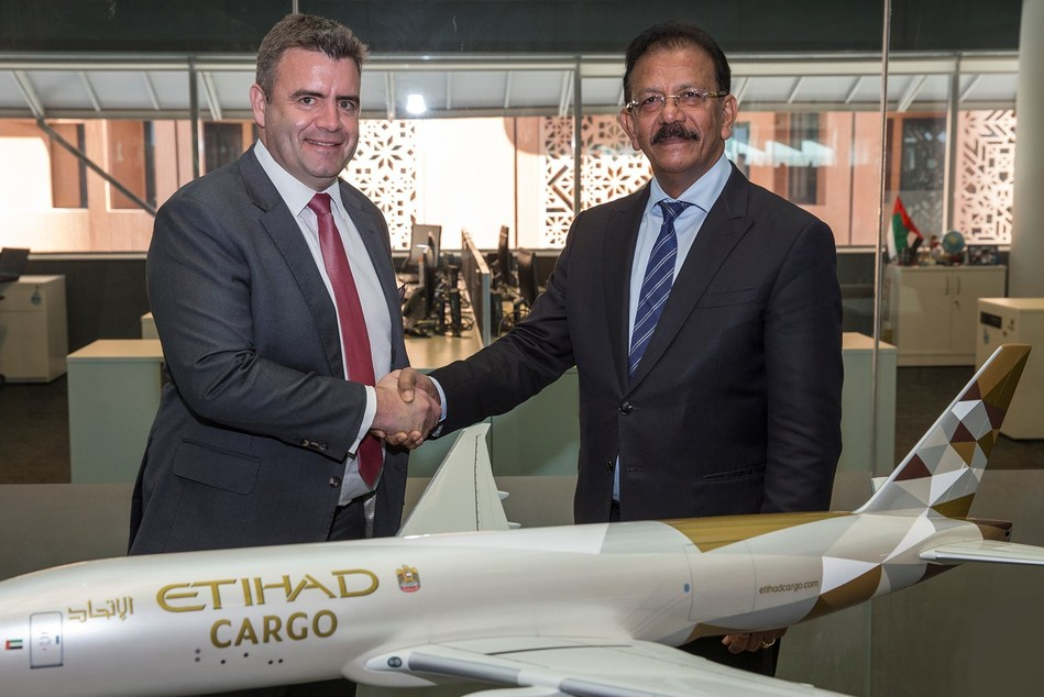 David Kerr, Senior Vice President, Etihad Cargo, and VK Mathews, Executive Chairman, IBS Group at the signing ceremony in Abu Dhabi (PRNewsfoto/IBS Software (IBS))