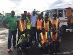 Prime Minister Roosevelt Skerrit (centre in white cap) with members of the 'clean-up crew'. (PRNewsfoto/Range Developments)