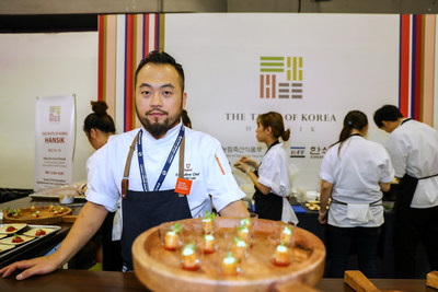 Chef David Lee at the KFF booth at NYCWFF with his gochu-jang chicken meatball dish. (PRNewsfoto/Korean Food Foundation)