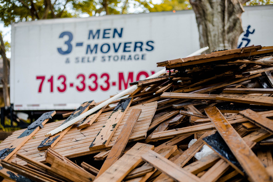 3 Men Movers truck at the home of a Houston resident whose home was devastated by Hurricane Harvey.