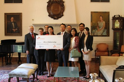 Y. Ping Sun, University Representative, holding check on center, and to her left is Lora Wildenthal, Interim Dean of Humanities, accepts a donation from SK Innovation. The check on left is head of SK Innovation's Exploration and Production(E&P) Business, DS Choi.