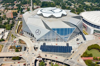 Solar panels in foreground are part of Georgia Power's 4,000-panel solar project at Mercedes-Benz Stadium. Photo credit: HHRM/Aerial Innovations
