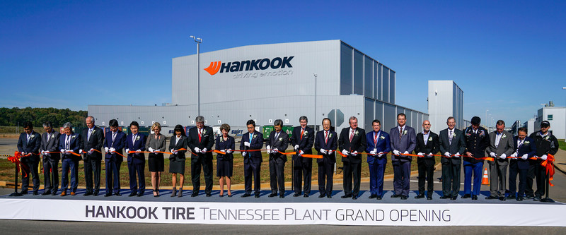 Hankook Tire executives and dealers join state and local government officials to celebrate the grand opening of the Tennessee Plant with a ribbon cutting ceremony in Clarksville, Tenn.