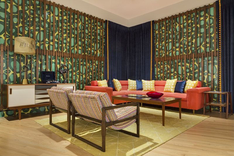 A 1950s lounge area is incorporated into the art collection. It was designed by Chris Goddard and shows how Davis's art influenced home décor in the early 20th century.