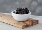 Scientific research has found that eating a serving of five prunes a day may help slow and prevent bone loss. (CNW Group/California Dried Plum Board)