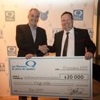 (de gauche à droite) M. Daniel Tremblay, président du conseil d'administration des Banques alimentaires du Québec et M. David Duval, président des Éleveurs de porcs du Québec. (Groupe CNW/Les Éleveurs de porcs du Québec)