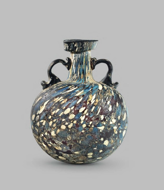 Roman, 1st century A.D.; Purple, yellow, blue and white glass; H: 16 cm (6.29 in) | PROVENANCE: Formerly, Benzian collection, Lucerne, Switzerland, prior to 1984; Sotheby's, London, 7 July 1994, Lot 134. | PUBLISHED: 3000 Jahre Glasskunst, Lucerne, 1981, p. 75, no. 235; KLEIN D. - LLOYD W. (eds.), The History of Glass, London, 1984, p. 27; Sotheby's, London, 7 July 1994, Lot 134.