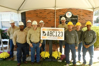 "Linemen representing the electric cooperatives of Georgia, Electric Cities of Georgia and Georgia Power pose with an example of the state's new ""Thank a Lineman"" specialty license plate. Proceeds will benefit burn patients and their families through the Southeastern Firefighters Burn Foundation. To purchase, visit http://www.sfbf.net/License-Plate."