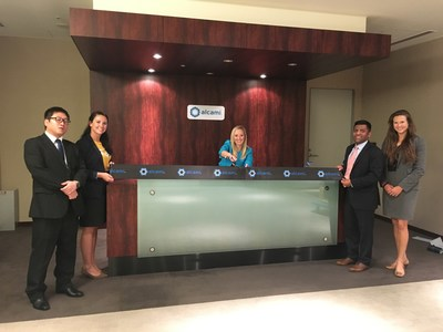 Executives and local partners participate in a ribbon cutting, commemorating the opening of Alcami's Asia-Pacific office.