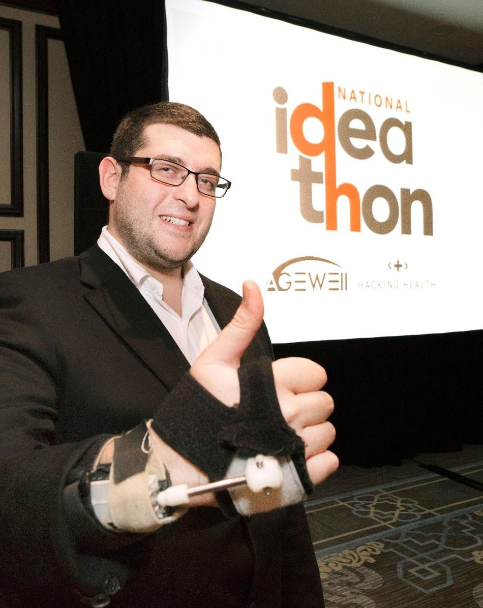 """Mark Elias, CEO of Steadiwear, shows an early prototype of a """"smart"""" glove designed to decrease hand tremors. (CNW Group/AGE-WELL Network of Centres of Excellence (NCE))"""