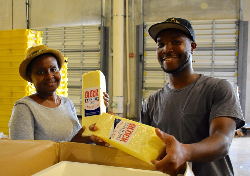 Good News, a partner agency of Feeding South Florida, are selecting calcium-rich cheese to distribute to food insecure families in Miami-Dade County.