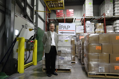 Scott Eithun, President of IPAP with Wisconsin Cheese donation to Irma victims.