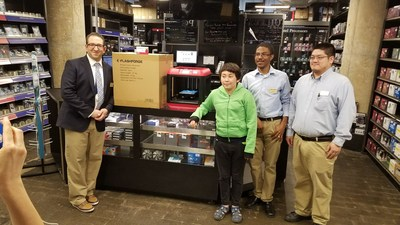 The winning student receives his 3D printer and Raspberry Pi from Micro Center Brooklyn general manager Robert Mucaria and associates Kevin Eubanks and Daniel Wang.