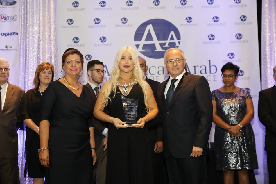 """Michigan Accident Attorney Joumana Kayrouz receives the """"The Economic Bridge Builder of the Year"""" award at the 25th Annual Arab American Chamber of Commerce """"Building Economic Bridges"""" gala Oct. 13, 2017 for her contributions to the business and legal community. Michigan Accident Attorney Joumana Kayrouz (center) is joined by Chamber Exec. Director Fay Beydoun and Board Chairman Ahmad Chebbani. (Photo courtesy of Joumana Kayrouz www.YourRights.com."""