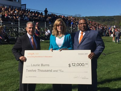 Doug Peters, regional vice president, Tax-Exempt Markets, and Chuck Williams, senior vice president, Tax-Exempt Markets, for Voya Financial present Voya's 2017 Unsung Heroes program second place winner Laurie Burns with the $12,000 grant award.