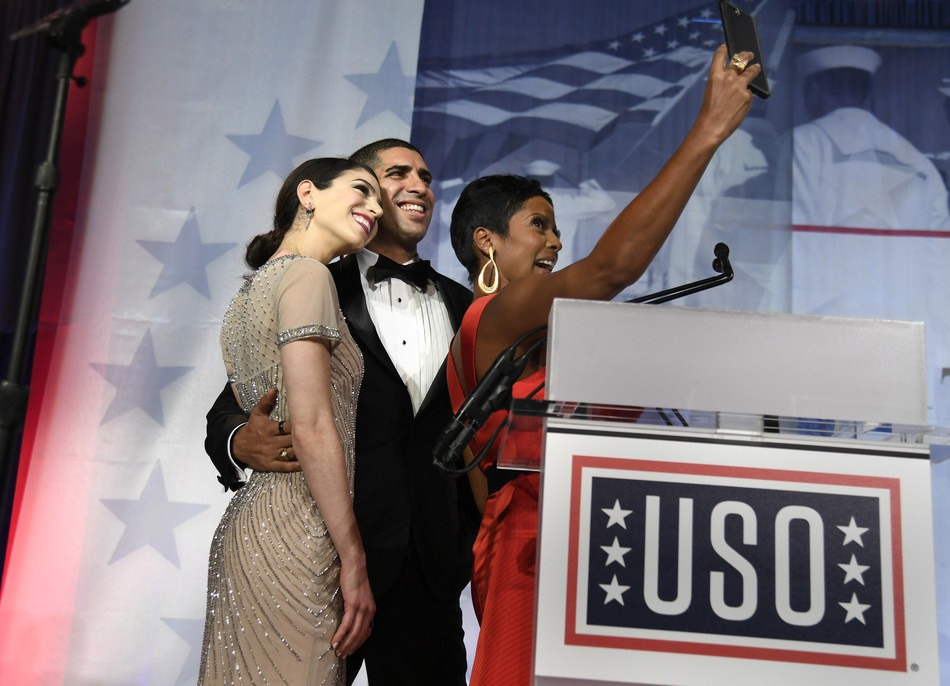 "Master of Ceremonies Tamron Hall takes a selfie with Medal of Honor recipient, retired Army Capt. Florent Groberg and his fiancée Carsen Zarin during the 2017 USO Gala on October 19 in Washington, DC. Groberg is the author of ""8 Seconds of Courage: A Soldier's Story from Immigrant to the Medal of Honor,"" to be released Nov. 7. He is currently the director of veterans outreach for Boeing. USO Photo by Mike Theiler"
