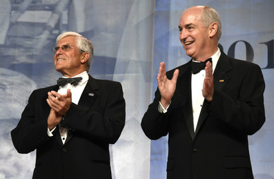 USO CEO and President Dr. JD Crouch II, right, and retired Army Gen. George W. Casey Jr., chairman of the USO Board of Governors, applaud remarks during the 2017 USO Gala on October 19 in Washington, D.C. USO Photo by Mike Theiler