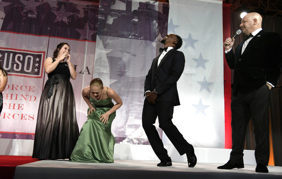 Guests brought up on stage break out in laughter as comedian Jeff Ross, right, makes jokes at their expense as he entertains during the 2017 USO Gala on October 19 in Washington, D.C. USO Photo by Mike Theiler
