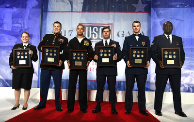 From left to right, USO Service Members of the Year Sgt. Sara Anne Cerne (Soldier), Cpl. Justin C. Ahasteen (Marine), Petty Officer 3rd Class Terence J. Parsons (Sailor), Staff Sgt. Richard Brandon Hunter (Airman), Petty Officer 3rd Class Keith A. Coddington (Coast Guardsman) and Senior Airman Leroy Manigault, Jr. (National Guardsman) pose with their awards at the conclusion of the 2017 USO Gala on October 19 in Washington, D.C.  USO Photo by Mike Theiler