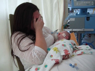 Landon Johnson exhibited signs of distress, including constant crying and nursing, while exclusively breastfeeding for 48 hours while in a Baby-Friendly hospital. He went into cardiac arrest 12 hours after discharge from hypernatremic dehydration. He developed unsurvivable brain injury and died at 19 days of age.
