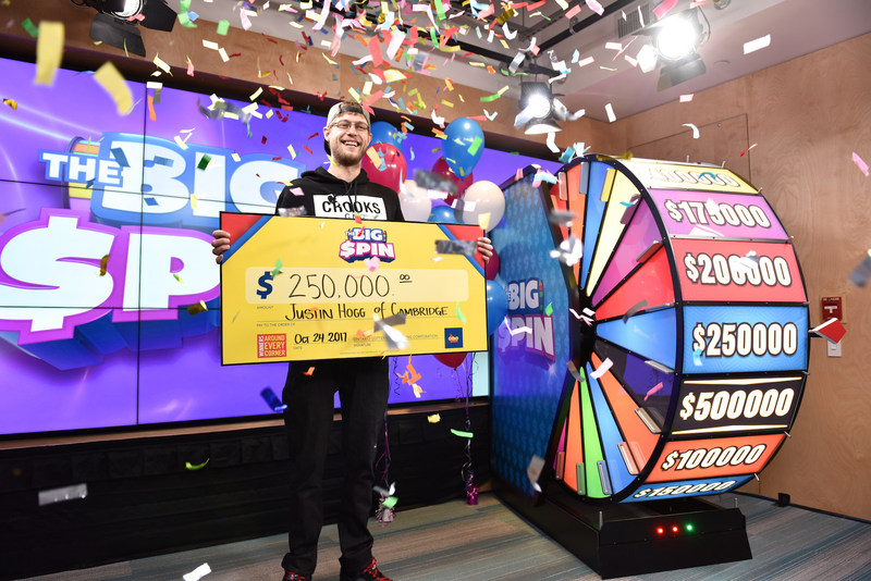 Justin Hogg of Cambridge celebrates after spinning THE BIG SPIN Wheel at the OLG Prize Centre in Toronto to win $250,000. Hogg won a top prize with OLG's new INSTANT game – THE BIG SPIN. (CNW Group/OLG Winners)