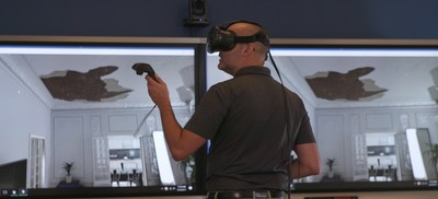 A Farmers Insurance employee tests his skills in accurately assessing a property loss using the insurers' new virtual reality claims training program