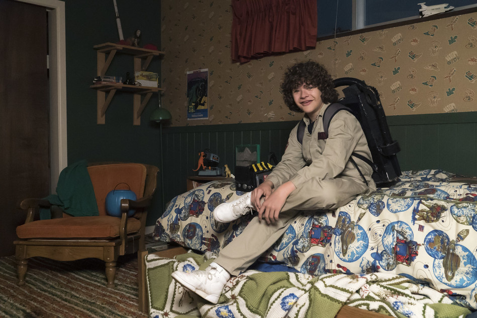 Dustin (Gaten Matarazzo) suited up on the set of Stranger Things 2 with all his Ghostbusters gear and custom sneakers.