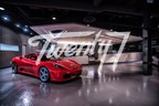 Glimpse of inside of the Twenty7 showroom with entertainment bar just behind the luxury vehicle (CNW Group/Twenty7 Social Club)