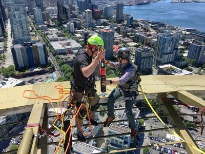 Panogs prepares for the 520' free fall of the camera used to produce the 360-degree VR video for the bungee jump.