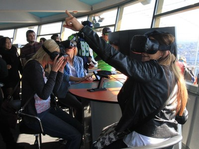 Guests try out the Space Needle's new VR experiences on the Observation Deck. The VR Bar was designed and installed by Graffix.