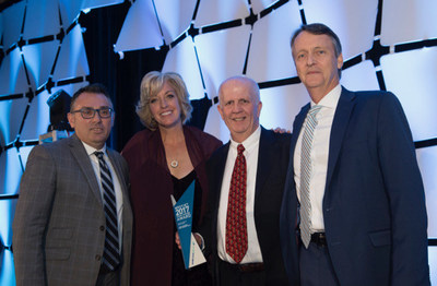 Jane Clementino (Director, Agency Sales) and Lyell Farquharson with the winners of WestJet Top Plus Sales Growth - American Express Global Business Travel (CNW Group/WestJet)