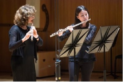 Performing with New York Philharmonic flute player Mindy Kaufman