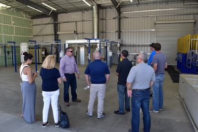 Pick Up Propane Manager Chad Richardson leads a tour for visitors at the new Jurupa Valley Production Center.
