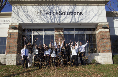 The Voice Solutions team welcomes fall outside their new office.