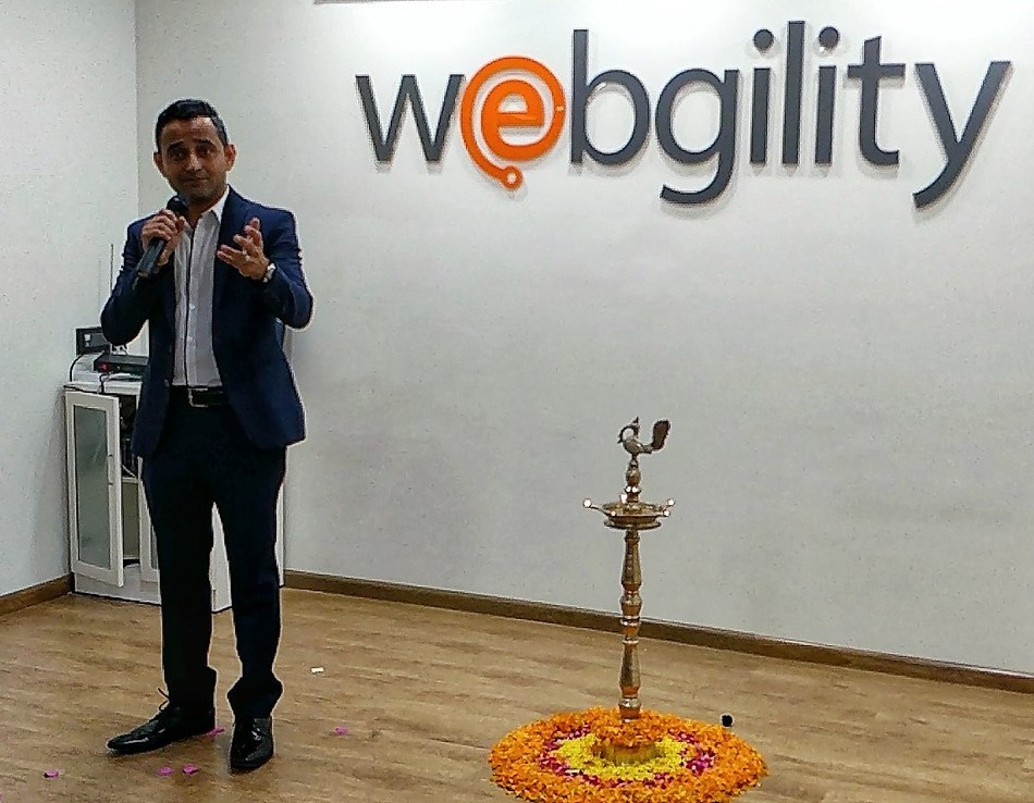Webgilty CEO Parag Mamnani makes remarks at the opening of the new office.