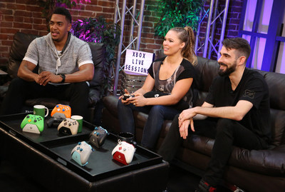 Ronda Rousey (middle) joins Xbox Live Sessions on Xbox One X with Rukari Austin (left) and Eric Porowski (right) on Thurs. Oct 26 in Los Angeles, CA (Casey Rodgers/AP Images for Xbox)