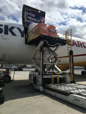 Medicines and medical supplies are loaded onto an airlift in Miami Friday, bound for Puerto Rico.