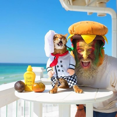 The $10,000 grand prize was awarded to @justmangobrown, depicted in a photo scene as a chef with his pet parent disguised as his cravable burger creation.
