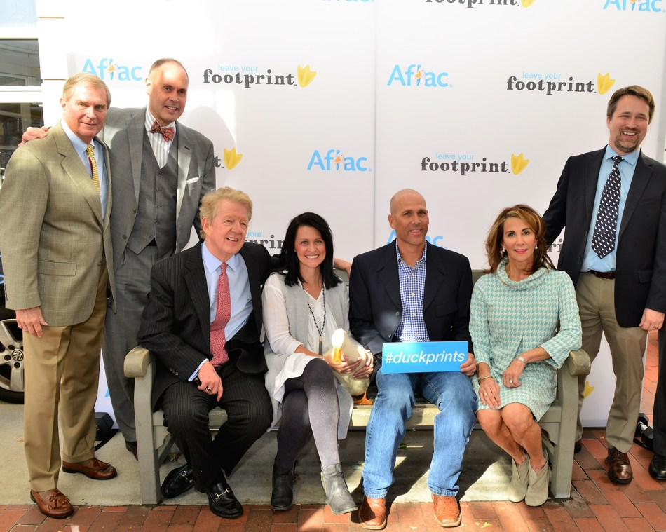 Aflac today honored three heroes who have left their footprints in the community through their significant contributions to the lives of families touched by childhood cancer. Left to right Shelton Stevens (honoree), national sportscaster Ernie Johnson Jr. (Emcee), Aflac CEO Dan Amos, Kim Hudson (honoree), former Major League All Star, Tim Hudson (honoree), Aflac Foundation President Kathelen Amos and Douglas K. Graham, M.D., Ph.D., Dir. of the Aflac Cancer at Children's Healthcare of Atlanta.