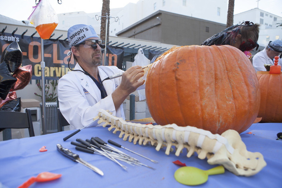 Brain Surgeon Kris Smith Operates on Halloween Pumpkin at Dignity Health St. Joseph's Hospital in Phoenix.