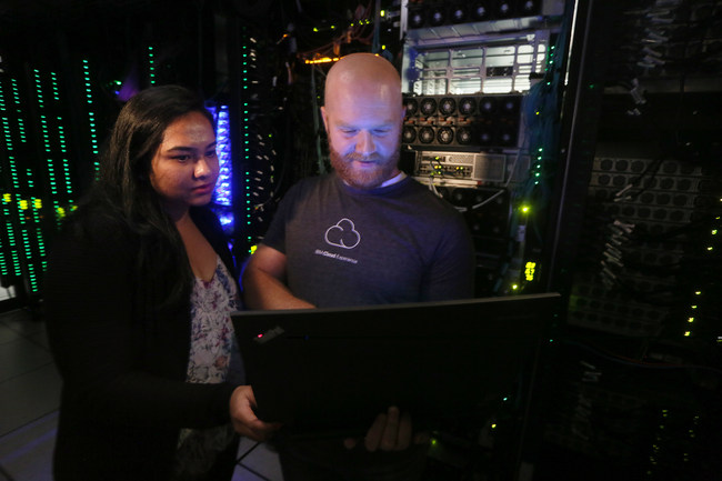 Software engineers Shibani Raikar, left, and Brad Hoover test IBM Cloud Private automation software in the IBM Cloud Innovation Lab in Austin, TX. On Wednesday, November 1, 2017, IBM announced IBM Cloud Private, a new software platform using open source container technology to help unlock billions of dollars in core data and applications built on enterprise software and extend cloud-native tools across public and private clouds. (Credit: Jack Plunkett/Feature Photo Service for IBM)