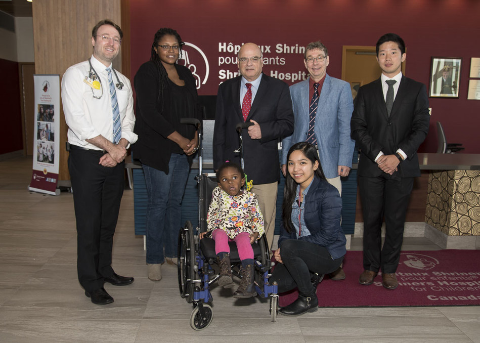 From left to right: Dr. Philippe Campeau, Mrs. Fraser (mother), Amaya, Dr. Reggie Hamdy, Dr. Dieter Reinhardt, Chae Syng (Jason) Lee, and Nissan Baratang (CNW Group/Shriners Hospitals For Children)