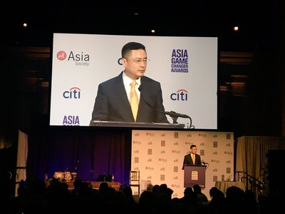 HNA Group CEO Adam Tan announces the donation of 1000 flights tickets to Asia Society at the Asia Game Changer Awards, New York City