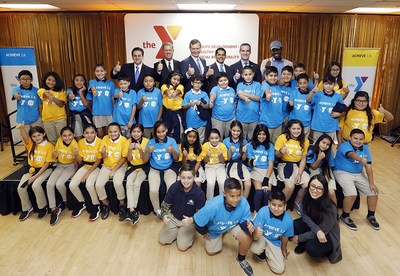Photo: Back row, from left to right, Cal State LA Executive Vice President Jose A. Gomez, YMCA of Metropolitan Los Angeles President and CEO Alan C. Hostrup, YMCA of Metropolitan Los Angeles Board Chair Mark Helm, Assemblymember Miguel Santiago, L.A. Mayor Eric Garcetti and Jaren Savage. They are with fifth-grade students from KIPP LA Prep. (Credit: J. Emilio Flores/Cal State LA)