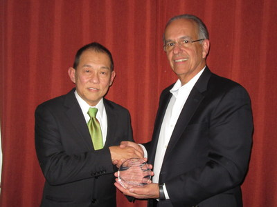 SeckLeong Lee of Albemarle and Jo Portela of CB&I accept the Kirkpatrick Chemical Engineering Award at a ceremony in New York City.
