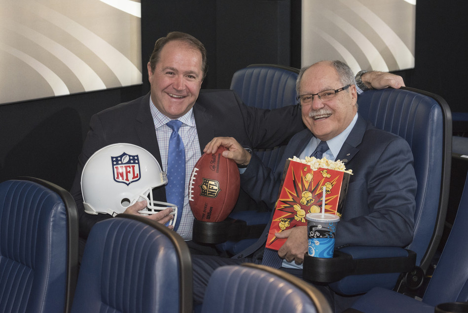 David Thomson, Managing Director, NFL Canada (pictured left) and Ellis Jacob, President and Chief Executive Officer, Cineplex (pictured right) celebrate a three-year sponsorship agreement that will bring Sunday Night Football and the Super Bowl live to Cineplex theatres across Canada. (CNW Group/Cineplex)