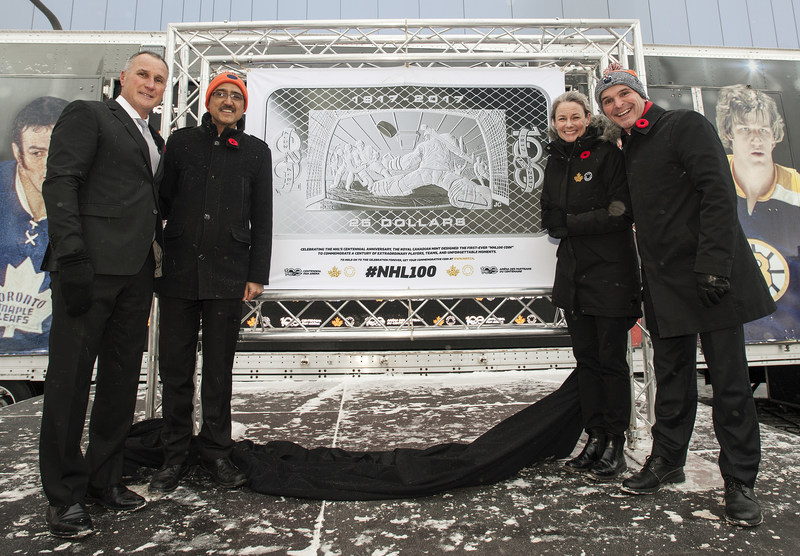 From left: Edmonton Oilers former star player Paul Coffey, the Hon. Amarjeet Sohi, Minister of Infrastructure and Communities, Royal Canadian Mint President Sandra Hanington and Edmonton Centre MP Randy Boissonault unveil the 100th Anniversary of the NHL silver collector coin in Edmonton, AB on November 3, 2017. (CNW Group/Royal Canadian Mint)
